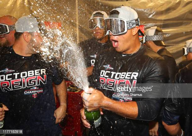Brusdar Graterol of the Minnesota Twins celebrates winning the American League Central Division title after a 51 win against the Detroit Tigers and a...