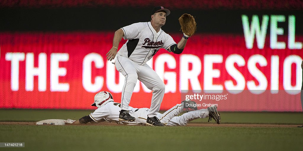 Bruse Braley, D-Iowa, waits for the ball as Sam Graves, R-MO., slides into 2nd safe during the 51tst Annual Roll Call Congressional Baseball Game held at Nationals Stadium, June 28, 2012.