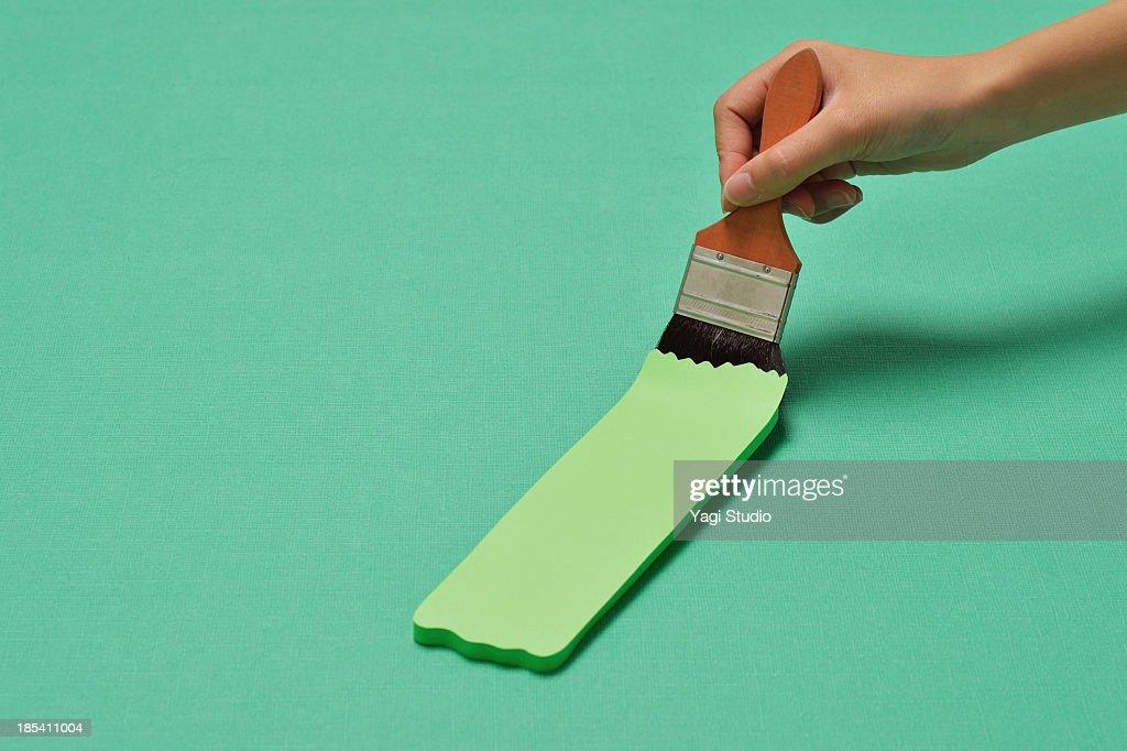 Brush and painting green : Stock Photo