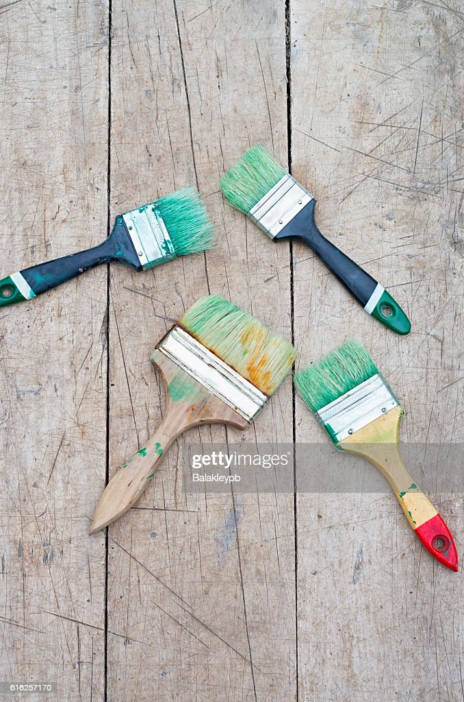 brush in green paint : Foto de stock