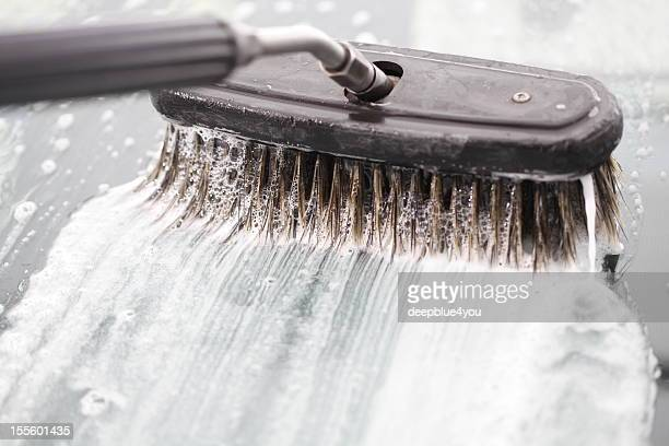brush is washing a blue car with foam - car wash brush stock pictures, royalty-free photos & images