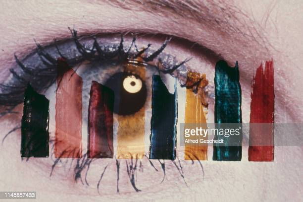 Brush strokes of different colors superimposed on a human eye with mascara on eyelashes, US, circa 1985.