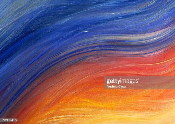 Brush strokes painted in shades of yellow, red and blue, close-up, full frame
