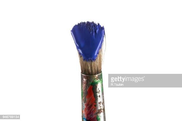 Brush with blue paint isolated on white background