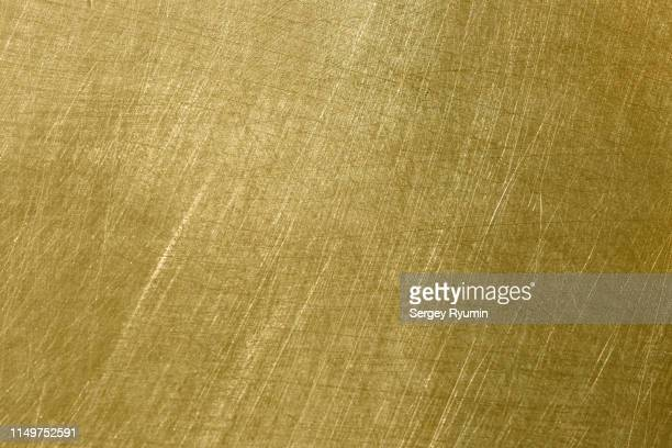 brushed metal surface - brass stock pictures, royalty-free photos & images