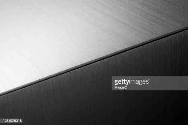 brushed metal surface splice - metall stock-fotos und bilder