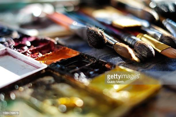 brushes and a watercolour palette. - art and craft equipment stock pictures, royalty-free photos & images