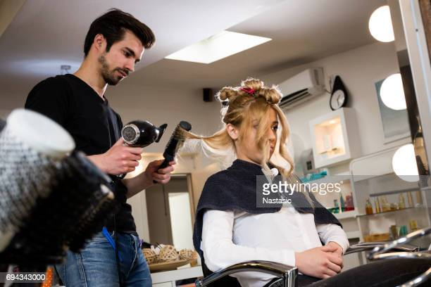 Brushing hair with hairdryer