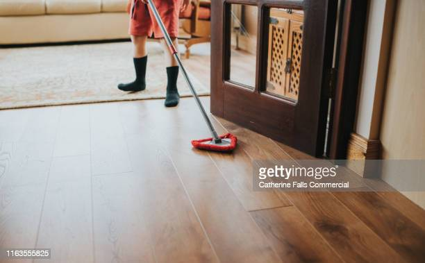 brushing the floor - sweeping stock pictures, royalty-free photos & images