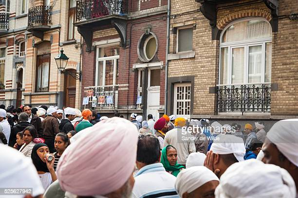 Brussels 2012 07 october. Sikh people mourn one week after the killing of a woman and her three children at their home in Etterbeek, Brussels. Police...