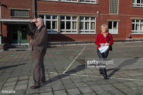 Brussels 2012 14 october Belgian municipal elections Mr Herman Van Rompuy and mrs Van Rompuy walk to vote in a school in Saint Genesius Rode where...