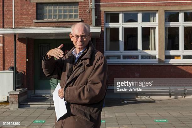 Brussels 2012 14 october. Belgian municipal elections. Mr Herman Van Rompuy after voting in a school in Saint Genesius Rode, where they live. Mrs Van...