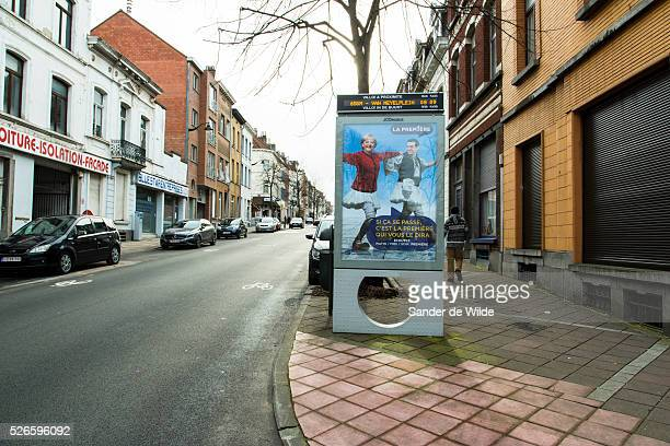 Brussels 25 february 2015 a poster in the street on a Villo sign by JCDECAUX shows a digital manipulation of Angela Merkel an the Greek leader of...