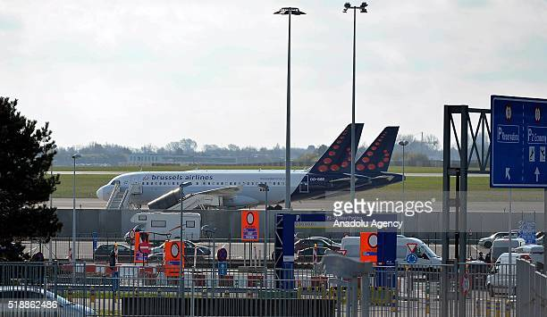 Brussels airlines planes wait at the flight line at the Zaventem airport on its reopening day near Brussels Belgium on April 3 2016 The airport has...