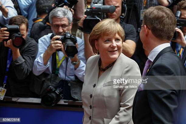 Brussels. Arrivals of heads of state at the beginning of a European Summit. Angela Merkel, Federal Chancellor of Germany welcomin gJyrki Katainen, PM...