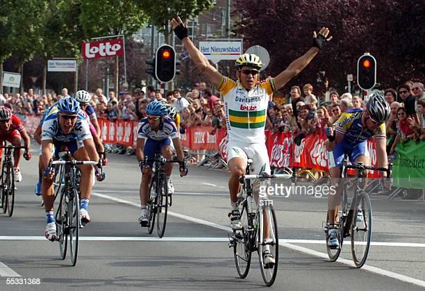 Australian Robbie Mc Ewen of Davidamon-Lotto celebrates his victory followed by Stefan Van Dijck, and Jean-Patrick Nazon of AG2R Prevoyance 10...