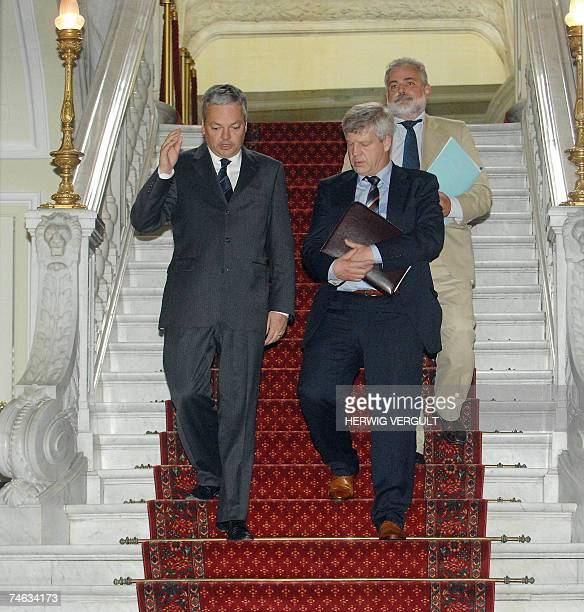 Belgian Deputy Prime Minister Didier Reynders and CGSLB/ACVLB liberal union chairman Jan Vercamst go down the stairs followed by CGSLB/ACVLB...