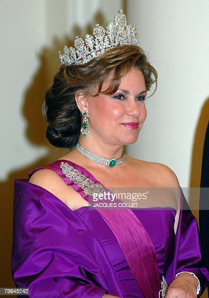 Clad in gala outfit, the Grande Duchess of Luxembourg Maria Teresa arrives for the diner at the Royal Castle of Brussels, on the occasion of the Duke...