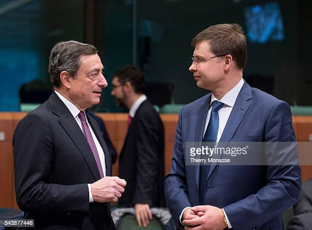 Brussels Belgium December 8 2014 President of the European Central Bank Mario Draghi is talking with the EU Euro Social Dialogue Commissioner Valdis...