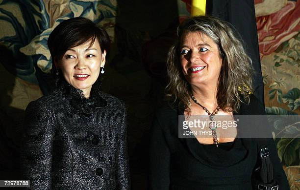Dominique Verkinderen the wife of Belgian Prime Minister Guy Verhofstadt and Akie Abe the wife of Japanese Prime Minister Shinzo Abe pose at the...