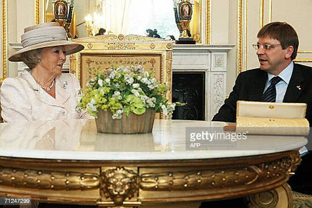 Dutch Queen Beatrix talks with Belgium's Prime Minister Guy Verhofstadt at the Royal Palace in Brussels, 20 June 2006. The Queen Beatrix is on a...