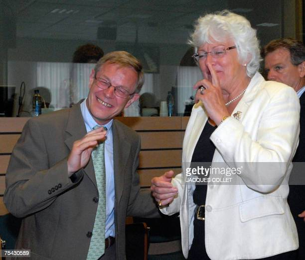 EU agriculture and rural development commissioner Mariann Fischer Boel Luxembourgian Agriculture Minister Fernand Boden laugh 16 July 2007 before the...