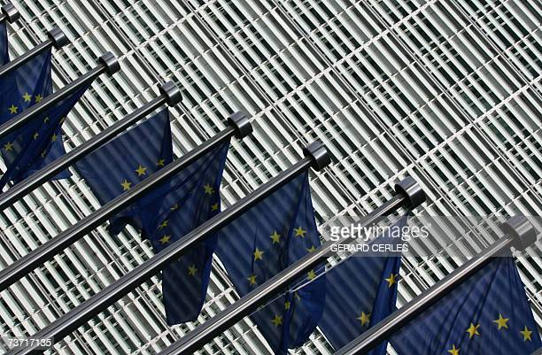 European Flags flutter at the entrance of the European Commission's Berlaymont building at the EU headquarters in Brussels 27 March 2007 Police in...