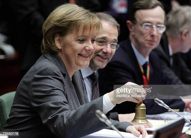 European Union Foreign Policy Chief Javier Solana looks at Germany's Federal chancellor Angela Merkel whose country currently holds the European...