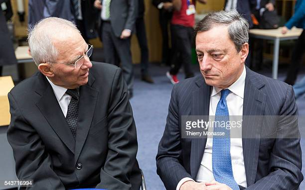 Brussels Belgium February 11 2015 German Finance Minister Wolfgang Schäuble is talking with President of the European Central Bank Mario Draghi prior...