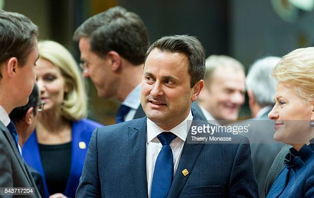 Brussels Belgium February 12 2015 Estonian Prime Minister Taavi Roivas is talking with the Luxembourg Prime Minister Xavier Bettel and the Lithuanian...