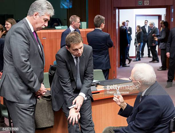 Brussels Belgium February 16 2015 Austrian Finance Minister Hans Jörg Schelling is talking with the Slovakian Finance Minister Peter Kazimir and the...