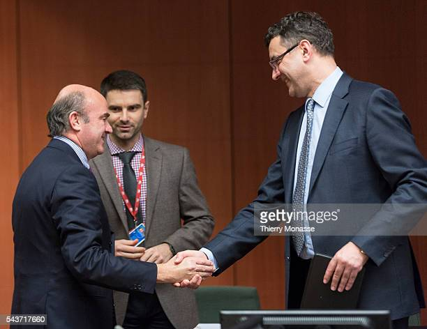 Brussels Belgium February 16 2015 Spanish Minister of Economy Competitiveness Luis De Guindos Jurado is talking with the Latvian Finance Minister...