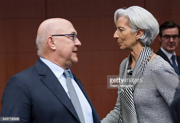 Brussels Belgium February 21 2015 French Finance Public Accounts Minister Michel Sapin is talking with the International Monetary Fund managing...