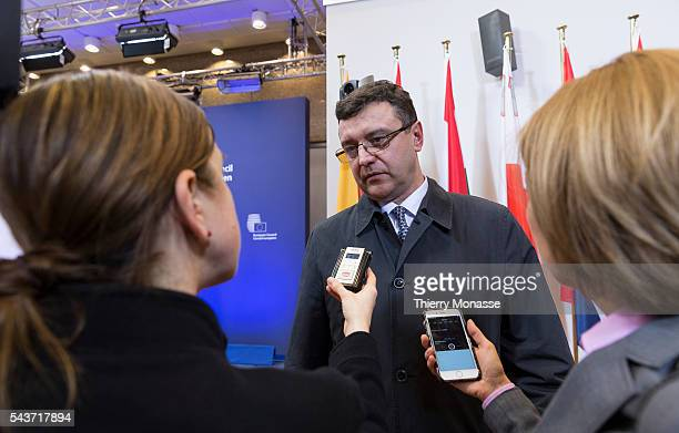 Brussels Belgium February 21 2015 Latvian Finance Minister Janis Reirs is talking to media as he arrives for an extraordinary € group Ministers...