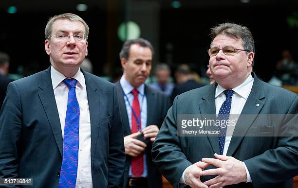 Brussels Belgium February 9 2015 Latvian Minister of Foreign Affairs Edgars Rinkevics is talking with the Lithuanian Minister of Foreign Affairs...