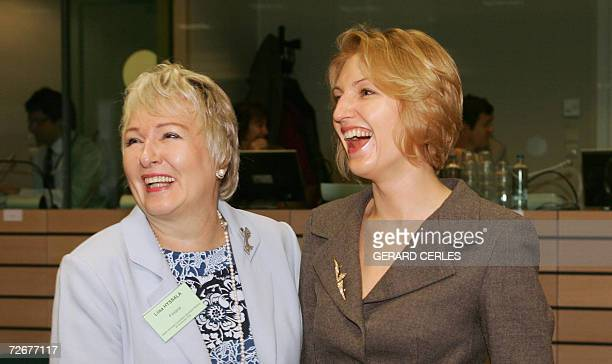 Finnish Minister of Social affairs and Health, and current Chairman of the Council Liisa Hyssala shares a laugh with Latvian Health deputy minister...