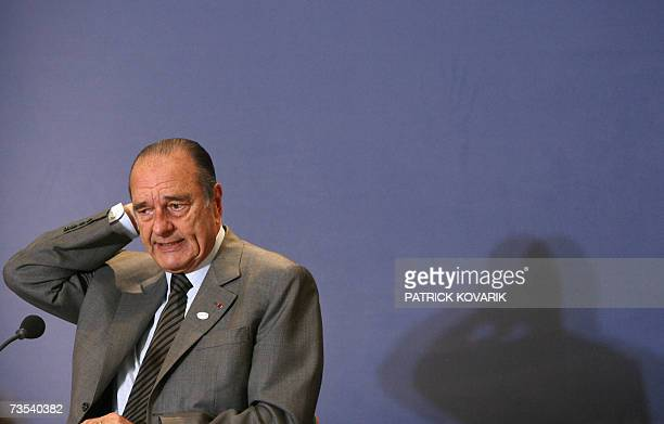 France's President Jacques Chirac gives a press conference following the closing session of the two-day EU summit at the EU headquarters in Brussels...
