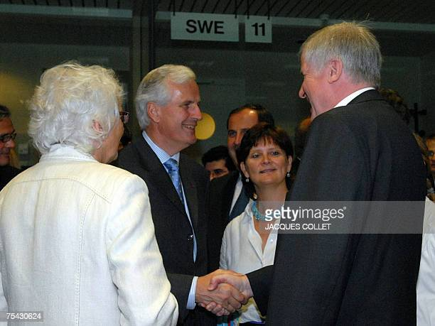 French Agriculture Minister Michel Barnier shakes hands with German Agriculture Minister Horst Seehofer as Belgian Agriculture Minister Sabine...