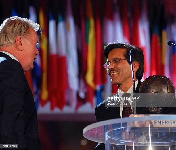 Indian representative Jyoti Prasad Painuly receives an Energy Globe award Fire Category from Hollywood star Martin Sheen during the Energy Globe...