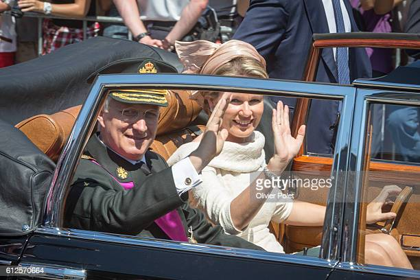 Brussels, Belgium, July 21, 2013 - King Philippe and Queen Mathilde of Belgium pictured during a limousine ride after the King's oath taking ceremony...
