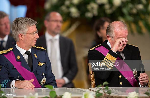 Brussels Belgium July 21 2013 Prince Philippe Duke of Brabant and the Belgium King Albert II are listening during the resignation ceremony in the...