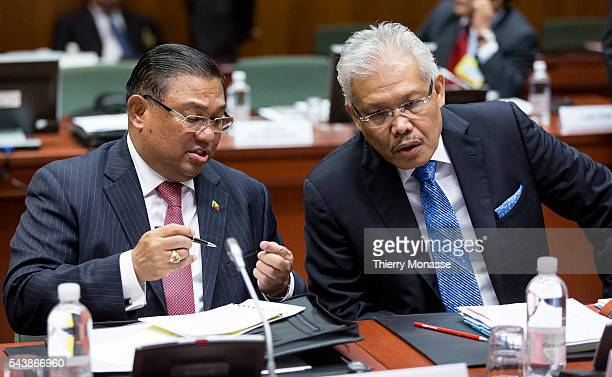 Brussels Belgium July 24 2014 Burma Minister of Foreign Affairs WUNNA MAUNG LWIN is talking with the Member of the Parliament of Malaysia Deputy...