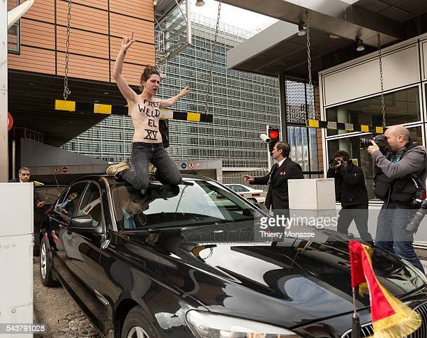 Brussels Belgium June 25 2013 FEMEN activists demonstrate while the Tunisian Prime Minister Ali LAAREYDH is leaving after a bilateral meeting in the...
