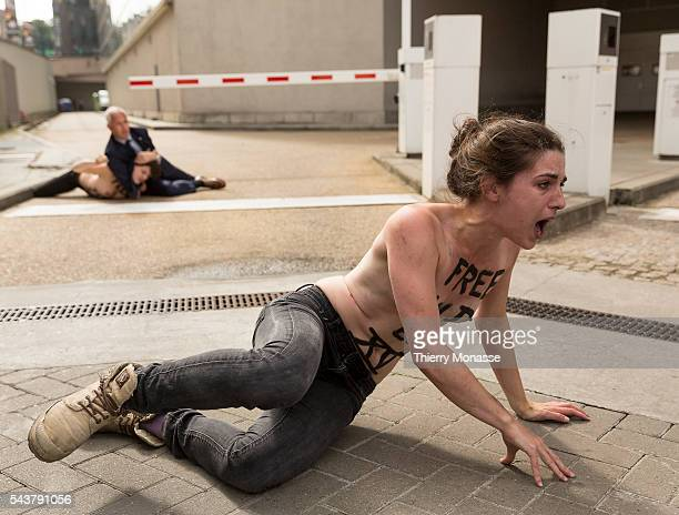 Brussels, Belgium, June 25; 2013. -- FEMEN activists demonstrate while the Tunisian Prime Minister Ali LAAREYDH is leaving after a bilateral meeting...