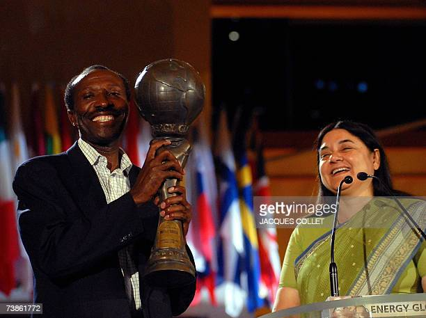 Kenyan representative John Kamau Maina holds up the Energy Globe award Earth Category received from the Member of Congress and former Environmental...