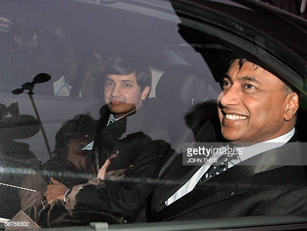 Mittal Steel chief executive Lakshmi Mittal leaves with his son and financial director Aditya Mittal from the Belgian goverment palace in Brussels 06...