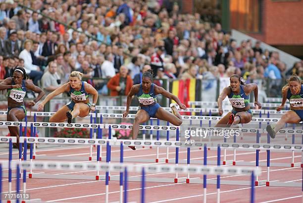 Danielle Carruthers, Swede Susana Kallur, winner US Michelle Perry, Jamaican Brigitte Foster-Hylton and US Lolo Jones vie in the women's 100 meters...
