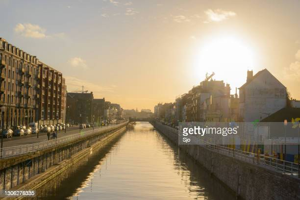 """brussels canal in belgium during sunset - """"sjoerd van der wal"""" or """"sjo"""" stock pictures, royalty-free photos & images"""