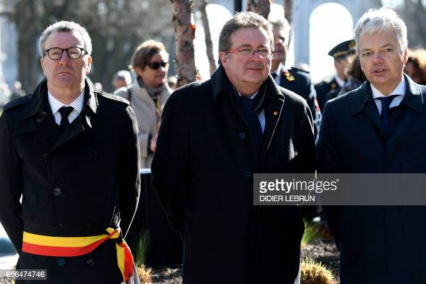 Brussels City mayor Yvan Mayeur Brussels region MinisterPresident Rudi Vervoort and VicePrime Minister and Foreign Minister Didier Reynders attend...
