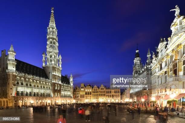 brussels grand place illuminated at dusk, belgium - グランプラス ストックフォトと画像